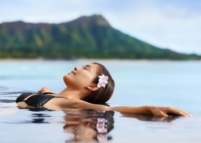 Hawaii vacation wellness pool spa woman relaxing